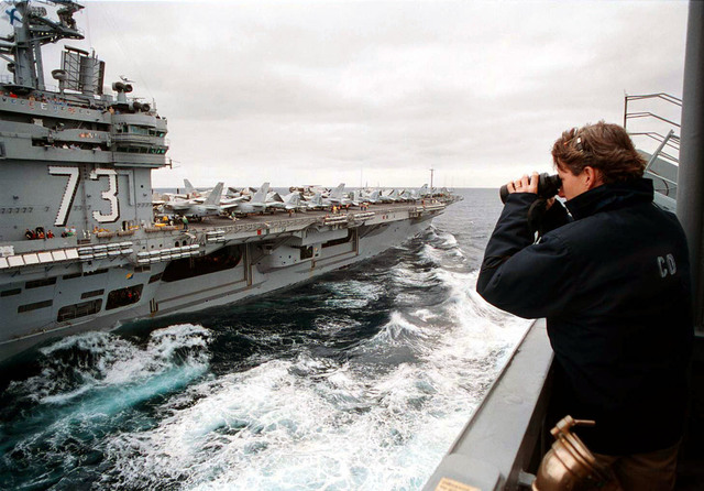 U.S. Navy Commander Roberta Spillane, Commanding Officer of the Cimarron Class Oiler, USS Merrimac (AO-179), monitors refueling operations with the USS George Washington (CVN-73). Both ships are on their way to the Adriatic Sea in support of Operatioin Joint Endeavor