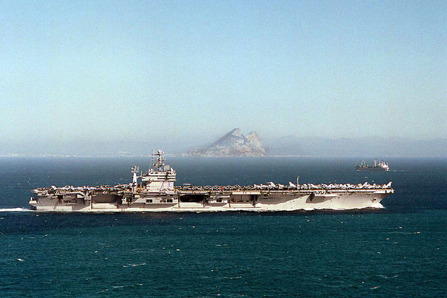 The nuclear powered aircraft carrier, USS George Washington (CVN-73), sails past the Rock of Gibraltar and into the Mediterranean Sea. the ship is on its way to the Adriatic Sea in support of Operation Joint Endeavor