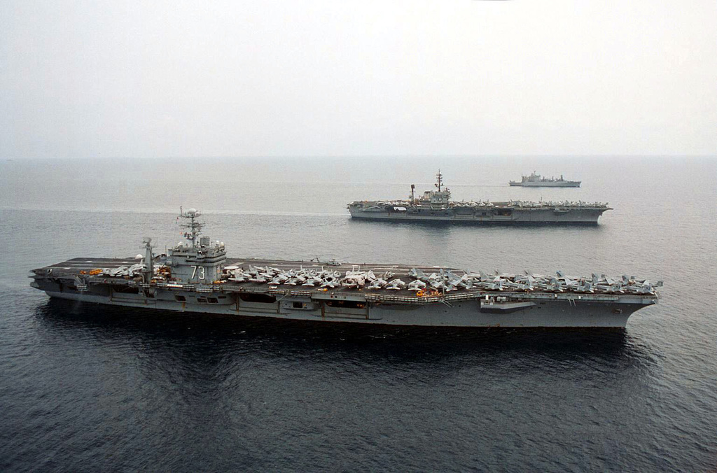 The US Navy's nuclear powered aircraft carrier USS GEORGE WASHINGTON (CVN 73) (bottom), the conventional carrier USS AMERICA (CV 66) (center), and the US Navy's Kilauea Class Ammunition Ship USS MOUNT BAKER (AE 34) (top), cruise the waters of the Mediterranean during turnover operations. George Washington assumed duties as part of Battle Force Sixth Fleet, while America prepared her return to their homeport of Norfolk, Virginia, following a highly successful six-month deployment that included operations in the Adriatic in support of NATO peace Operation JOINT ENDEAVOR