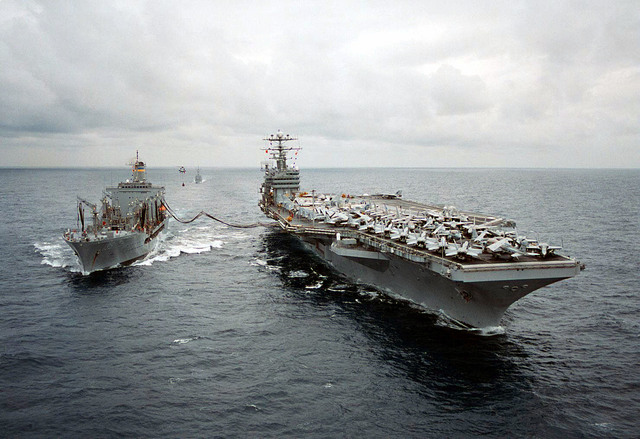 USNS Leroy Grumman (TAO 195) transfers fuel to the U.S. Navy nuclear powered aircraft carrier USS George Washington (CVN 73) during underway replenishment operations en-route to the Adriatic Sea. The USS George Washington, commanded by Captain Malcolm P. Branch, will operate in the Adriatic Sea in support of Operation Joint Endeavor