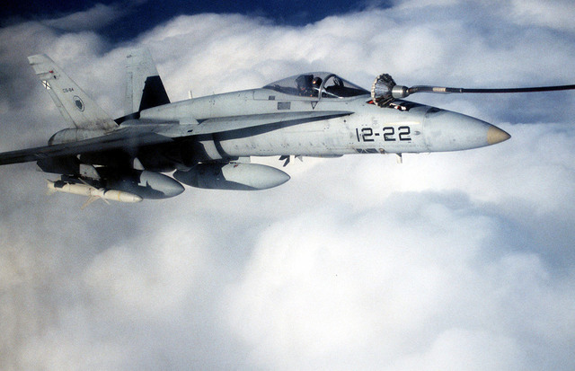 A Spanish F/A-18 from Aviano AB, Italy, gets refueled by a C-130 over the Adriatic Sea during Operation Decisive Edge in support of Operation Joint Endeavor