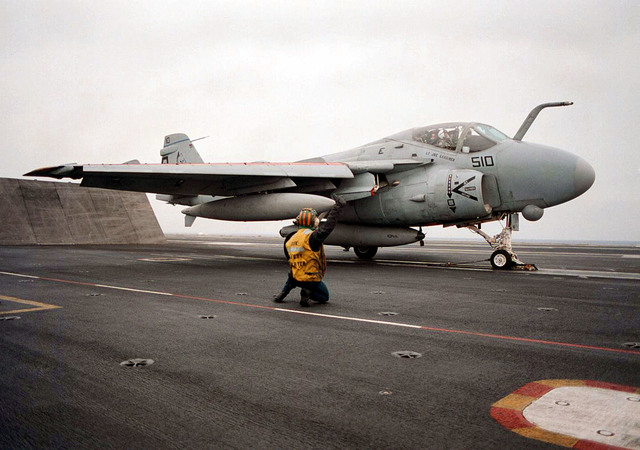 On board the U.S. Navy USS George Washington (CVN-73), located in the Adriatic Sea, an A-6E Intruder assigned to the Blue Blasters of Fighter Attack Squadron Three Four (VA-34), prepares to launch from the flight deck in the support of Operation Joint Endeavor