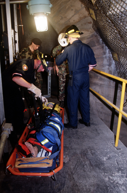 "At the entrance to Cheyenne Mountain Air Station, the ORI scenario was: ""Workman down with broken ankle on roof of air conditioning mechanical bay."" Responding to the radio call, the fire department, after locating the victim, put a splinter on his legs, placed him onto a stokes litter, rigged a hoist and performed a vertical rescue by lowering him off the roof for transport to the hospital. They were participating in the 21st Space Wing's Operational Readiness Inspection conducted at Cheyenne Mountain Air Station and Peterson AFB, Colo., 13 to 17 February 1996. The Inspector General's Team tested their ability to respond to battle conditions, power outages, mobility deployments, aircraft..."