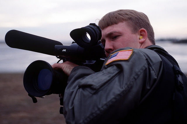 SENIOR AIRMAN Philip Nichols, 1ST Combat Camera Squadron, Charleston AFB, South Carolina, records on video camera the take-offs and landings of fighter aircraft at Aviano Air Base Italy during Operation Decisive Edge on 8 Jan 96