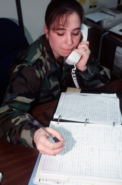 AIRMAN 1ST Class Lisa Fullencamp takes a report and logs names (simulated casualties) in the casualty report from the Battle STAFF. As part of the ORI, when simulated casualties were declared dead it was the responsibility of the Personnel Control Center and the Casualty Reporting Team to request replacements, notify the next of kin, and start survivor benefits. The 21st Space Wing's Operational Readiness Inspection was conducted at Cheyenne Mountain Air Station and Peterson AFB, Colo., 13 to 17 February 1996. The Inspector General's Team tested their ability to respond to battle conditions, power outages, mobility deployments, aircraft and automobile accidents, hostage situations, bomb ...
