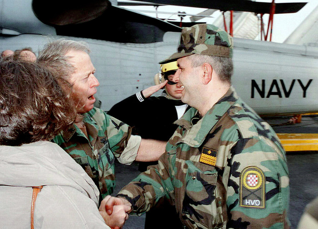 Admiral Leighton W. Smith (left), Commander of the NATO led Implementation Forces (IFOR), welcomes Major General Zivko Budimir, Commander-in CHIEF, Croatian Counsel of Defense, to the USS George Washington (CVN-73). Admiral Smith and General Budimir are on board to conduct the first in a series of Joint Military Commission meetings in support of Operation Joint Endeavor