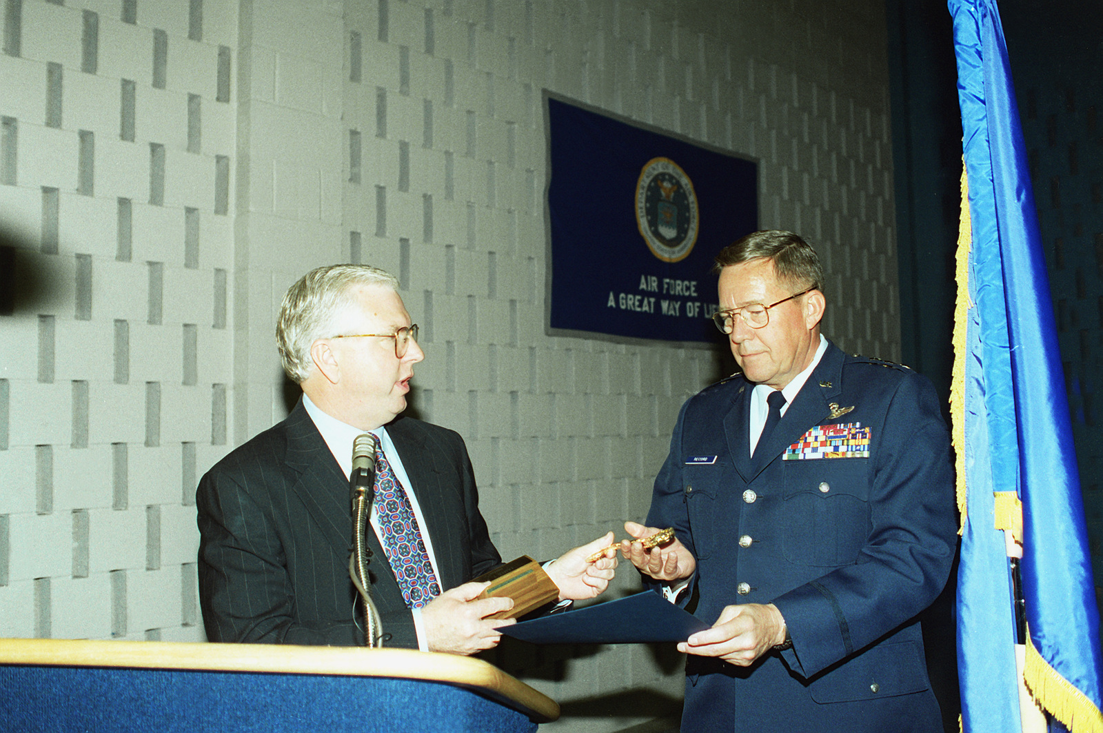 Bobby Burns, Mayor of Midland, Texas, presents LT. GEN. James Record, 12th Air Force Commander, with the key to the city of Midland. The Mayor also dedicated an official day in the general's honor