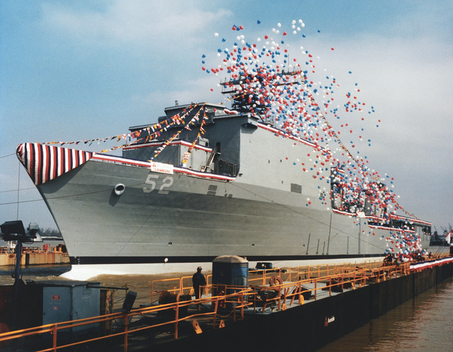 A port bow view of the dock landing ship PEARL HARBOR (LSD-52) while being pulled into a floating drydock shortly after christening and launch at the Avondale Industries, Inc. Shipyard on the Mississippi River near New Orleans. PEARL HARBOR is the ninth and last LSD built by Avondale. She is the first ship named for Pearl Harbor, one of the better known names in naval history