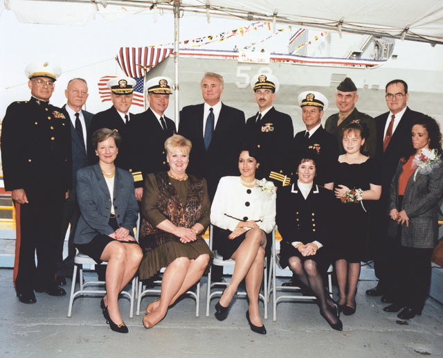 Official party at the christening and launch of the dock landing ship PEARL HARBOR (LSD-52). Top row, left to right, Brig. GEN. Frederick R. Lopez, USMCR, Assistant Division Commander 4th Marine Division; E. E. Shoults, PMS-377, Naval Sea Systems Command; CAPT. E. David Whidden, Supervisor of Shipbuilding, Conversion and Repair, New Orleans; Rear Adm. Paul M. Robinson, USN, PED CLA, Naval Sea Systems Command; U.S. Representative C. W. Bill Young; CMDR James J. Byrd, Jr., USN, P.C.O. USS PEARL HARBOR; Adm. Jeremy Boorda, USN, CHIEF of Naval Operations; Brig. GEN. Randy West, USMC, representing the Commandant of the Marine Corps; Albert L. Bossier, Jr., Chairman, President, and CEO of ...