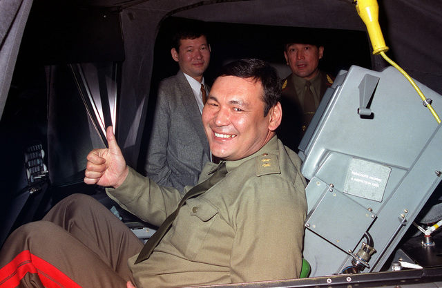 GEN. LT. Alibek Kasymov, the Minister of Defense for the Republic of Kazakstan, gives a thumbs up after his turn on the F-16 flight simulator