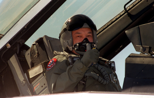 GEN. MAJ. Tokasyn Buzabayev, the First Deputy of STAFF from the Republic of Kazakstan, gives a thumbs up prior to his incentive flight in an F-16
