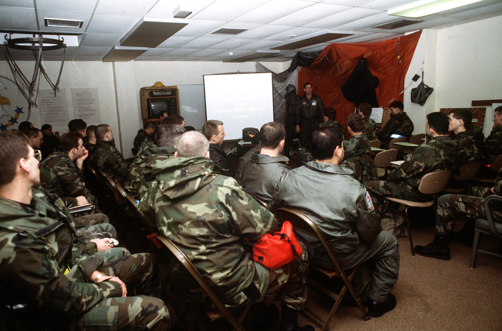 """48th Fighter Wing members receive an in-processing briefing at """"Farout"""" Air Base during a NATO Tactical Evaluation"""