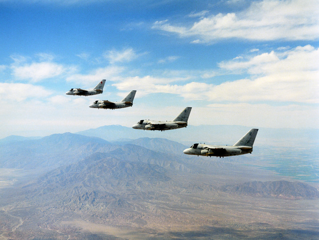 A four ship, in Echelon left formation of S-3B Vikings from the Sea Control Squadron 38 (VS-38), Red Griffins, Naval Air Station North Island (NASNI), California, in flight over El Centro during a Bombing Exercise. Exact date photo taken unknown