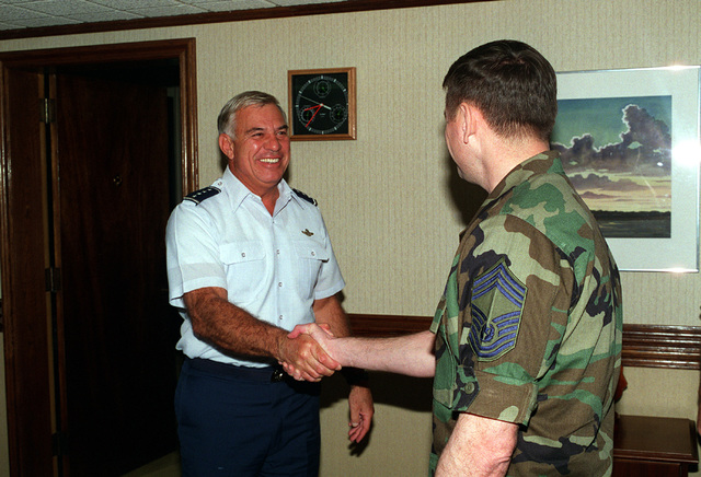 GEN. John G. Lorber, Commander USPACOM, shakes hands with CHIEF MASTER SGT. of the Air Force, David Campanale. Exact Date Shot Unknown