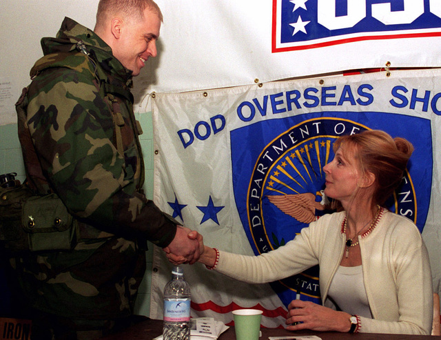Gates McFadden, star of Star Trek, The Next Generation, signs autographs and shakes hands after her performance. Her appearance is sponsored by the USO for Task Force Eagle soldiers stationed in Tuzla