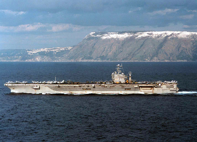 A port beam view of the nuclear powered aircraft carrier USS George Washington (CVN 73) as it transits north through the Strait of Messina, March 5, 1996. Commanded by CAPT Malcolm P. Branch, USS George Washington is currently on a scheduled six month Mediterranean deployment which includes operations in the Adriatic Sea in support of the NATO-led Operation Decisive Endeavor