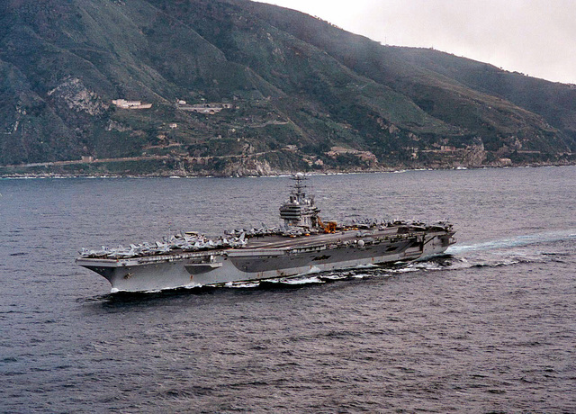 A port side view of the nuclear powered aircraft carrier USS George Washington (CVN 73) as it transits north through the Strait of Messina, March 5, 1996. Commanded by CAPT Malcolm P. Branch, USS George Washington is currently on a scheduled six month Mediterranean deployment which includes operations in the Adriatic Sea in support of the NATO-led Operation Decisive Endeavor