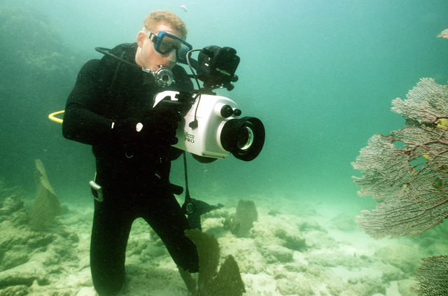 Photographers Mate Third Class (PH3) Paul Goodknight shoots video tape footage using an underwater camera during training from the Underwater Photographic Team off the Key West coast