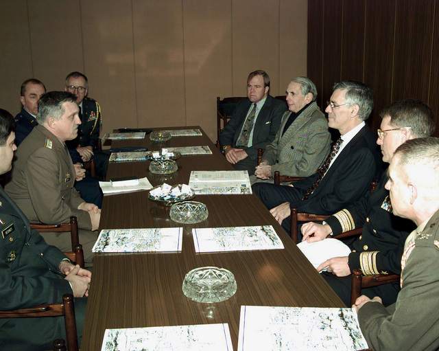 Undersecretary of the Army Joseph Reeder (right rear); U.S. Ambassador to Hungary Donald Blinken; Undersecretary of the Navy Richard Danzig; and Rear Admiral Charles Abbot, Director, J-3, EUCOM, listen to a briefing by Colonel Nagy, CHIEF, International Relations Department, Hungarian Ministry of Defense