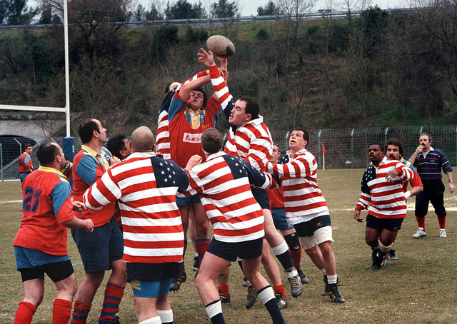 The Rugby Team from the nuclear powered aircraft carrier, USS George Washington (CVN 73), struggles for control of the ball during a game with a local rugby club played while the ship is visiting Marseille, France, March 9, 1996. The game is one of several athletic events hosted by citizens of Marseille for the benefit of the crew members during the port visit of 7-11 March. Commanded by CAPT Malcolm P. Branch, USS George Washington is currently on a scheduled six-month deployment and has operated in the Adriatic Sea in support of the NATO-led peace keeping mission, Operation Decisive Endeavor