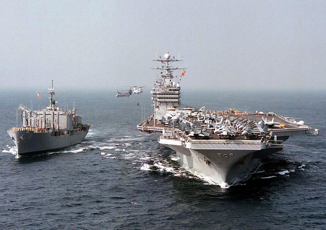 The Military Sealift ship USS San Diego (TAFS 6) and the nuclear powered aircraft carrier USS George Washington (CVN 73) conduct a vertical replenishment (VERTREP) using two CH-46 Sea Knight helicopters while operating in the central Mediterranean Sea, March 11, 1996. George Washington pulled anchor earlier in the day after a four-day port visit to Marseille, France. Commanded by CAPT Malcolm P. Branch, USS George Washington is currently on a scheduled six-month deployment and has operated in the Adriatic Sea in support of the NATO-led peace keeping mission Operation Decisive Endeavor
