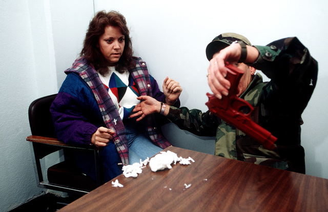 STAFF SGT. Donna Harrington, a Patrol Officer from the 90th Security Police Squadron, searches TECH. SGT. Brandy Creel, an Inspector General member from Peterson AFB, playing the part of an hysterical wife. Two concealed weapons were found, a gun and a knife. The Inspector General Team tested the ability of the base to respond to battle conditions, power outages, mobility deployments, aircraft and automobile accidents, hostage situations, bomb threats, armed robberies, terrorism, and communication problems