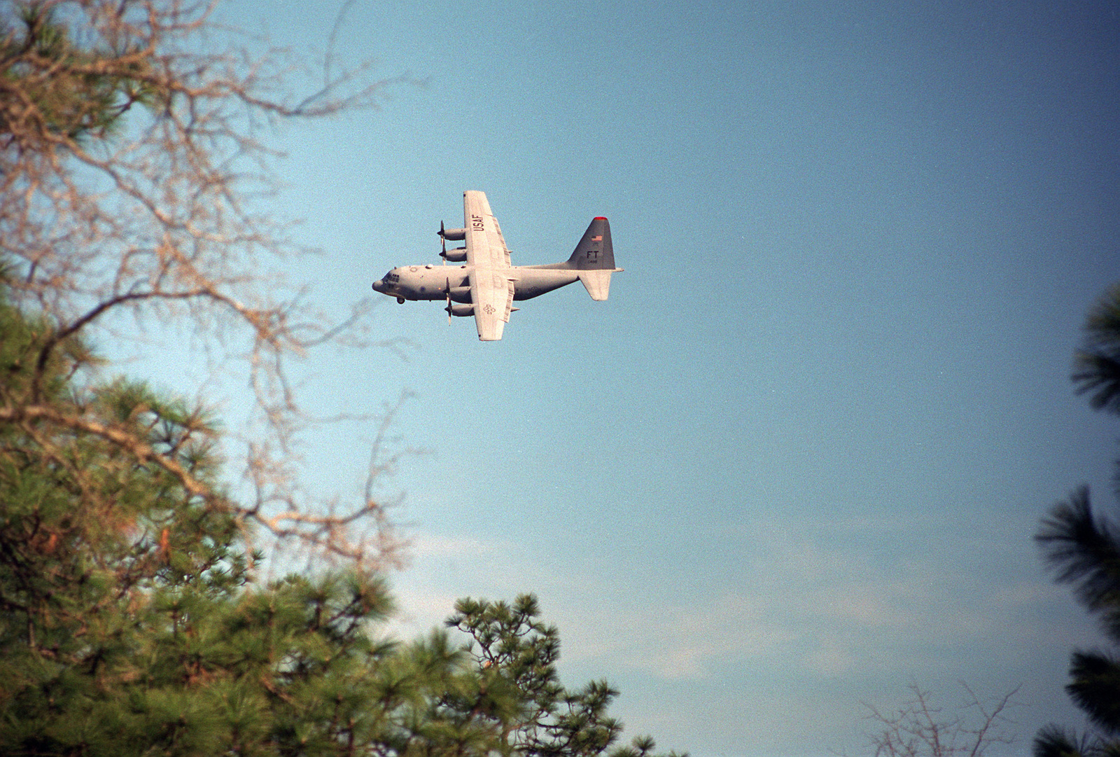 An Air Force C-130 in flight during mission support at the Joint Readiness Training Center