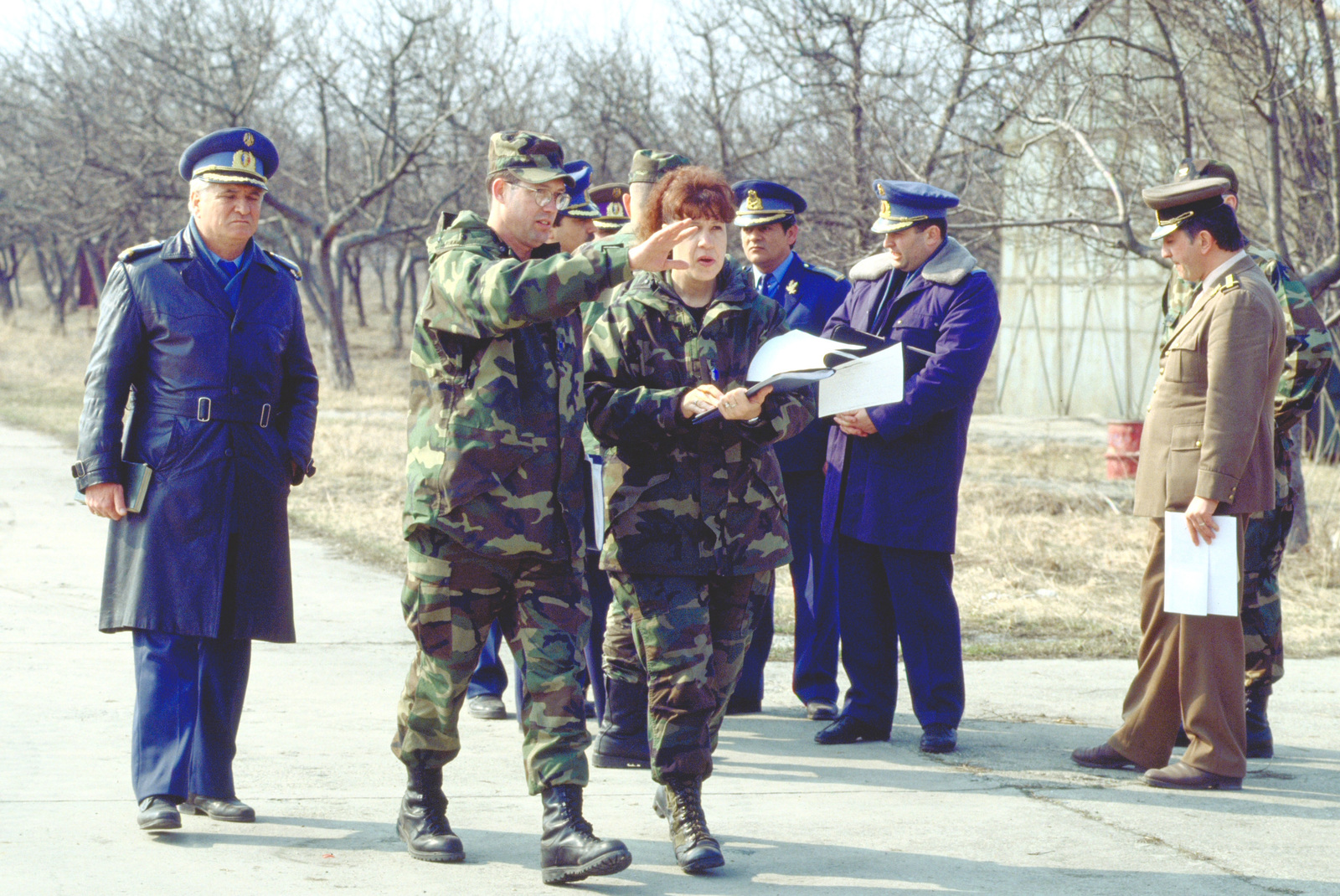 MASTER Sergeant Michele Helms (right), 16th Air Force, Logistics, Aviano Air Base, Italy discusses the airfield survey checklist with MASTER SGT. Ed. LaRosa, 616th Regional Planning Flight Services at Timisoara Air Base. They are members of the airfield survey team who, at the request of Romanian officials, will determine if the Romanian bases meet US and NATO standards for use in operations and exercises