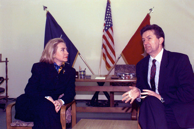 At Tuzla Air Base, during Operation Joint Endeavor, First Lady Hillary Clinton speaks with Ejup Ganic, the Bosnia-Herzegovinian vice-president, to discuss future plans in the war torn country. Mrs. Clinton is the only First Lady since Eleanor Roosevelt to visit a combat area