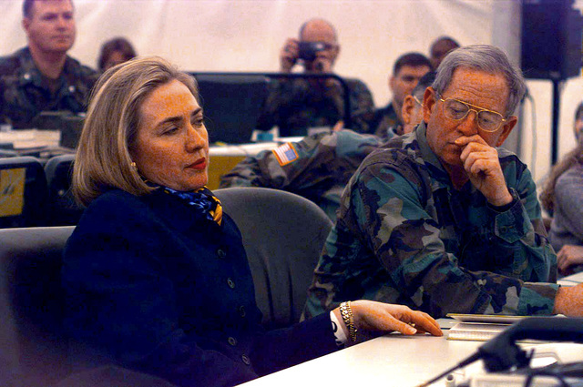 First Lady, Hillary Clinton, at Tuzla Air Base in Bosnia-Herzegovina, discusses American troop conditions with Implementation Force (IFOR) Commander, Admiral Leighton Smith. Mrs. Clinton is the only First Lady since Eleanor Roosevelt to visit a combat area