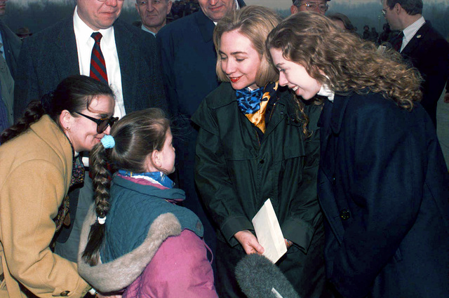 First Lady Hillary Clinton visits Tuzla Air Base in Bosnia-Herzegovina to meet local school children, Bosnian civic leaders, American troops and their commanders. Eight year old Bosnian student, Emina Bicikcic, reads a poem to the First Lady. Mrs. Clinton is the first First Lady to visit a combat area since Eleanor Roosevelt