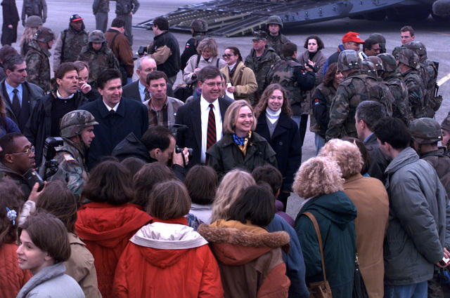 First Lady, Hillary Rodham Clinton and daughter Chelsea are greeted at Tuzla Air Base by soldiers from the first Armored Division, school children from the Tuzla area and members of the press during Operation Joint Endeavor