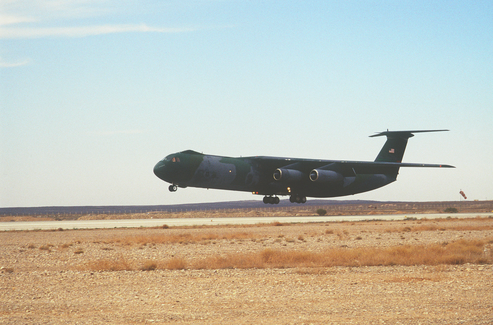 A C-141B aircraft from McChord Air Force Base, Washington is about to land at an airfield in Jordan. The aircraft is carrying cargo and personnel that are participating in the Air Power Expeditionary Force that is taking place in the country of Jordan. An ancillary mission of the Force is to assist US Air Force and other multinational forces operating in Saudi Arabia and other nearby countries patrol the no-fly zone over southern Iraq