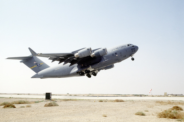 A C-17A Globemaster III aircraft from the 14th Airlift Squadron, Charleston Air Force Base, South Carolina takes off from a Jordanian Air Base after unloading personnel and cargo for the upcoming joint, United States/Jordan military exercise, Air Power Expeditionary Force. An ancillary mission of the force is to assist US Air Force and other multinational forces operating in Saudi Arabia and nearby countries patrol the no-fly zone over southern Iraq