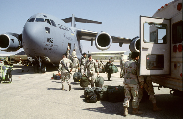 Personnel from the 347th Security Police Squadron, Moody Air Force Base, Georgia and the 4th Security Police Squadron, Seymour-Johnson Air Force Base, North Carolina deplane from a C-17A Globemaster III aircraft assigned to the 14th Airlift Squadron, Charleston Air Force Base, South Carolina at an air base in Jordan. Personnel will be participating in the upcoming joint, United States/Jordan, military exercise, Air Power Expeditionary Force Operation