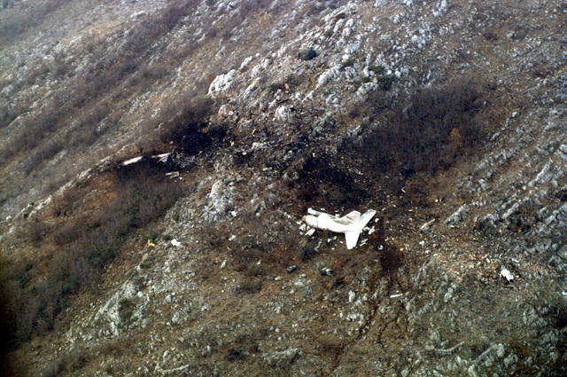Shown is an aerial view of the crash site of a T-43A jet aircraft located approximately 5 kilometers north of Dubrovik Airport, Croatia, during Operation JOINT ENDEAVOR. The aircraft was carrying Secretary of Commerce Ronald H. Brown, a Delegation of Executives from US Corporations, members of the press, and military personnel on board at the time of crash, which killed all on board