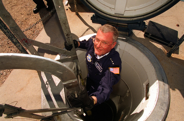 Chairman of the Joint Chiefs of STAFF, GEN. John Shalikashvili emerges from the capsule of missile site Echo 1