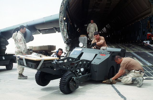 An MJ-1 weapons loader is unloaded from a C-5 Galaxy from the 3rd Airlift Squadron, Dover Air Force Base, Delaware, in support of the Air Power Expeditionary Force exercise with the Royal Jordanian Air Force