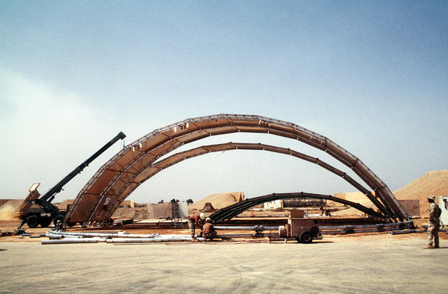Personnel from the 49th Material Maintenance Group, Holloman Air Force Base, New Mexico, construct a temporary aircraft hangar which will be used by participants in the Air Power Expeditionary Force exercise with the Royal Jordanian Air Force