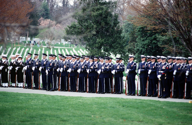 US Honor Guardsman are standing at rest at Arlington National Cemetery as they await the remains of Commerce Secretary Ron Brown who was tragically killed when a USAF CT-43 plane crashed near Dubrovnik, Croatia on April 3, 1996
