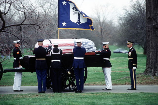 US Honor Guardsman, from all branches of the US military, are placing the remains of Commerce Secretary Ron Brown upon a horse drawn caisson. Commerce Secretary Ron Brown was tragically killed when a USAF CT-43 plane crashed near Dubrovnik, Croatia on April 3, 1996