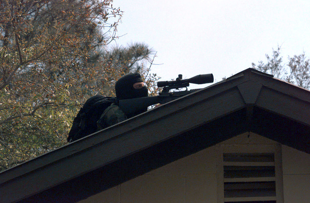 A sniper from the 16th Special Operations Wing (SOW) Security Police Squadron observes a mock terrorist during the 16th SOW Operational Readiness Inspection at Hurlburt Field, Florida