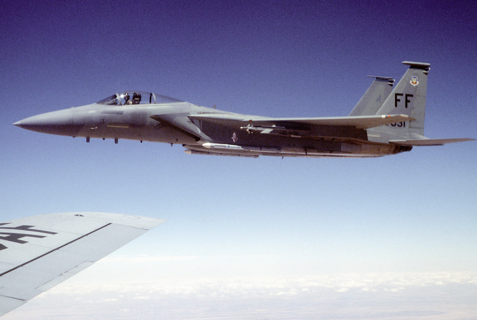 An F-15C Strike Eagle from the 94th Fighter Squadron, Langley Air Force Base, Virginia, flies off the wing of a KC-135 after being refueled by the tanker from the 96th Air Refueling Squadron, Fairfield Air Force Base, Washington, during a mission over Jordan, in support of the Air Power Expeditionary Force. An ancillary mission of the Force is to assist US Air Force and other multinational forces operating in Saudi Arabia and other nearby countries patrol the no-fly zone over southern Iraq