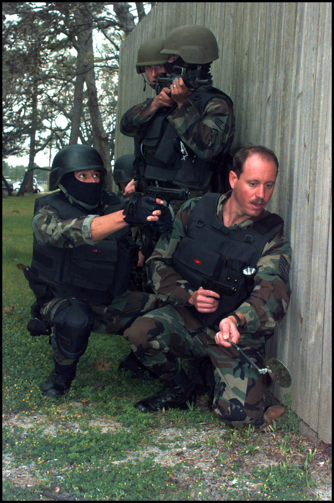 US Air Force Airmen from the 16th Security Police Squadron (SPS) at Hurlburt Field, FL, take part in the16th Special Operations Wing Operational Readiness Inspection (ORI), responding to a mock terrorist hostage situation. The Policemen ware protective body armor and are armed with 9mm M9 Beretta pistols and one carries the 5.56mm colt M4 carbine rifle
