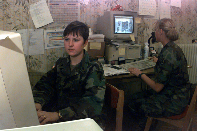 SPECIALIST Amanda Griffin from the 221st Public Affairs Detachment, a reserve unit from Schwetzingen, Germany, types a story on her computer. SPECIALIST Griffin is the Editor of the American Endeavor in Taszar, Hungary during Operation Joint Endeavor. PHOTO by Sergeant Angel Clemons