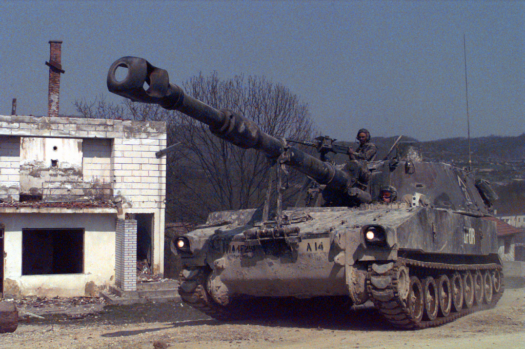 On the afternoon of April 22nd, 1996, an M109-A2, 155mm, self propelled Howitzer waits on the road by a bombed out building near the town of Donje Ceparde in the Zone of Separation in support of Operation Joint Endeavor