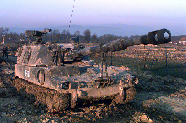 On the morning of April 22nd, 1996, an M109-A2, 155mm, self propelled, Howitzer, that belongs to 1ST Platoon, A Battery, 4th Battalion, 29th Field Artillery Regiment, warms to the rising sun at Camp Steel Castle, Bosnia, in support of Operation Joint Endeavor