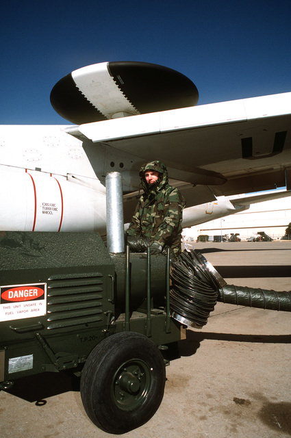 SENIOR AIRMAN Michael Minnick, 952nd Aircraft Generation Squadron, operates an H-1 heater during preflight operations on an E-3 AWACS (Airborne Warning and Control System) aircraft.(Published in AIRMAN Magazine May 1996 ) Exact Date Shot Unknown
