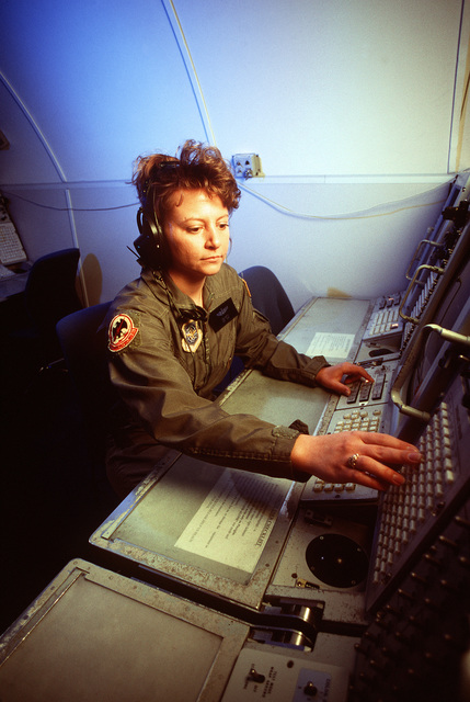 STAFF SGT. Tina Hutts, an air surveillance technician reservist, operates a display panel in the E-3 aircraft simulator.(Published in AIRMAN Magazine May 1996 ) Exact Date Shot Unknown
