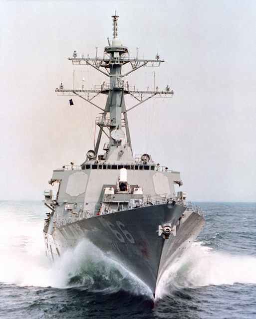 A bow-on (off centerline) view of the guided missile destroyer USS GONZALES (DDG 66) underway at high speed during builder's sea trials
